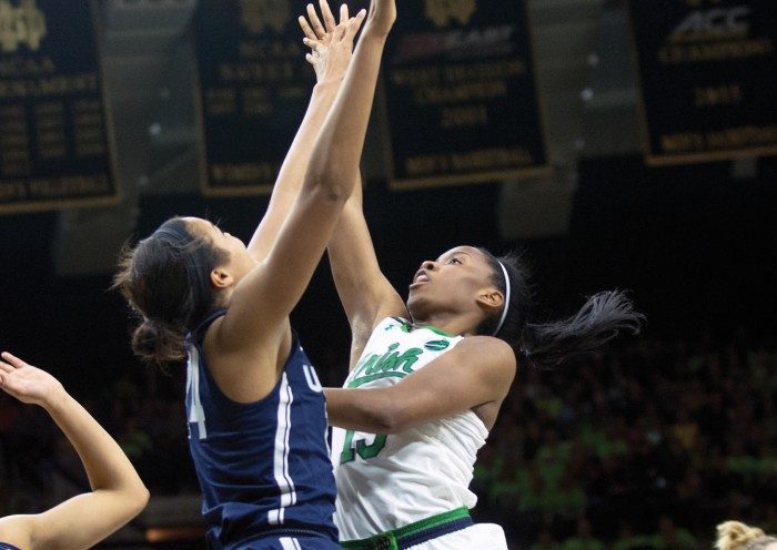 Irish senior guard Lindsay Allen floats the ball over a Huskies defender during Notre Dame's 72-61 loss to UConn on Dec. 7 at Purcell Pavilion.