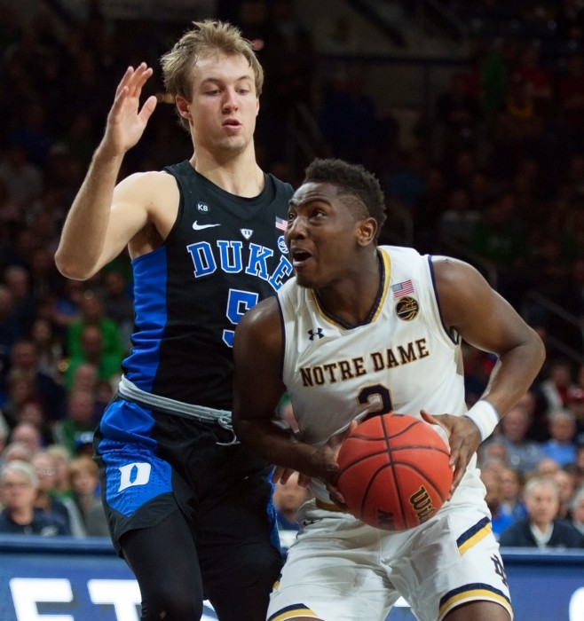 Irish freshman guard T.J. Gibbs attempts a pump fake in Notre Dame's loss to Duke on Monday at Purcell Pavilion.