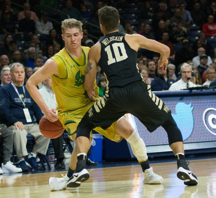 Irish sophomore guard Rex Pflueger looks to drive past a Demon Deacon defender during Notre Dame's 88-81 win over Wake Forest on Tuesday at Purcell Pavilion.