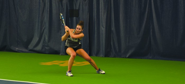 Irish senior Jane Fennelly returns her opponent's shot during Notre Dame's 6-1 win over Indiana on Feb. 20 at Eck Tennis Pavilion.