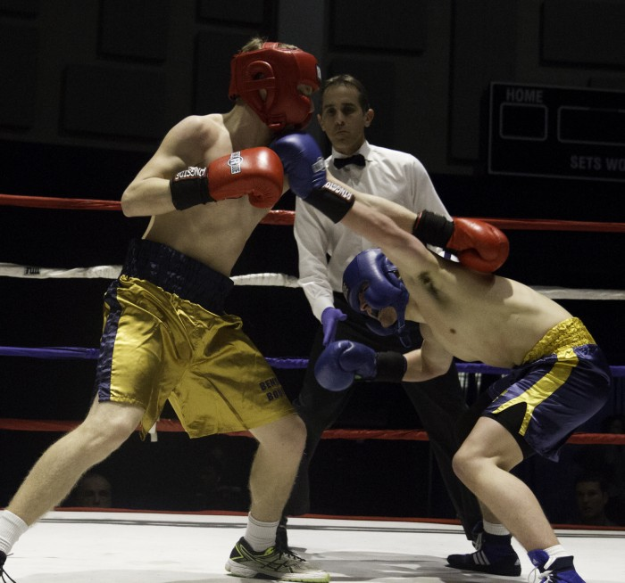 Freshman Jonny Biagini, right, ducks to avoid a punch from freshman Ian Salzman during the prelimary round of the 87th annual Bengal Bouts tournament on Tuesday at the Joyce Athletic and Convocation Center.
