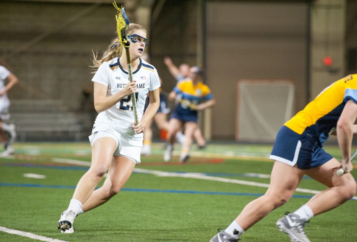 Irish senior attack Grace Muller cradles the ball during Notre Dame's 21-9 win over Marquette on Feb. 14 at Loftus Sports Center.