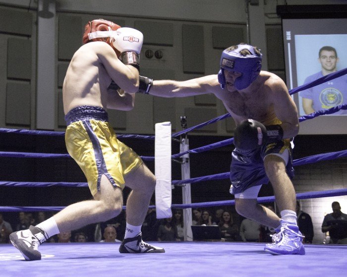 Senior captain Jack Corrigan lands a right jab to the chest of sophomore Michael Krecek during a 174-pound semifinal bout Monday at the Joyce Center Fieldhouse. Highlights of Corrigan's four-year Bengal Bouts career include helping break the fundraising goal in 2016 and traveling to Bengladesh to witness the Holy Cross missions.