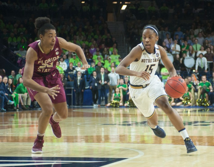 Irish senior guard Lindsay Allen dribbles past a defender during Notre Dame's 79-61 win over Florida State on Feb. 26 at Purcell Pavilion.