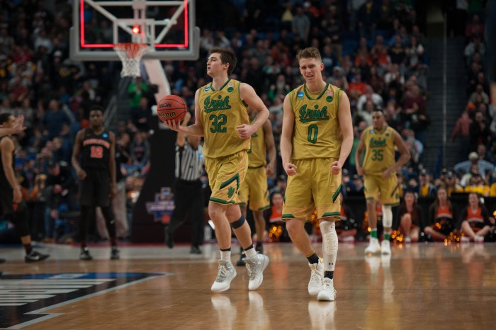 Irish sophomore guard Rex Pflueger celebrates after Notre Dame's 60-58 victory over Princeton on Thursday at KeyBank Arena. Pflueger had four points in the contest, after requiring stitches after taking an elbow to the head.