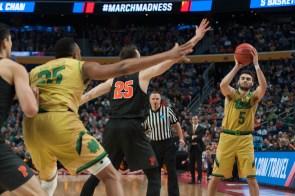Irish junior guard Matt Farrell looks to pass the ball to his teammate.