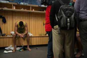 Irish junior forward Bonzie Colson unwinds as reporters interview his teammates after the team's loss to West Virginia.