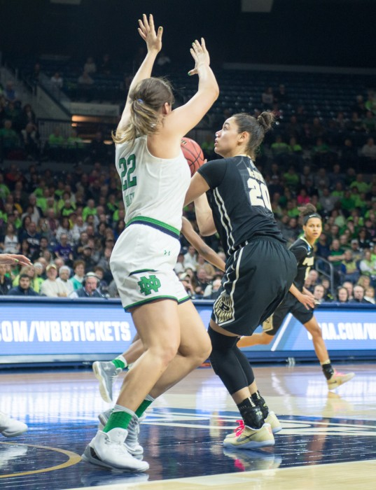 Irish freshman forward Erin Boley defends the paint against Boilermakers sophomore forward Dominique McBryde during Notre Dame's 88-82 overtime win over Purdue on Sunday at Purcell Pavilion.