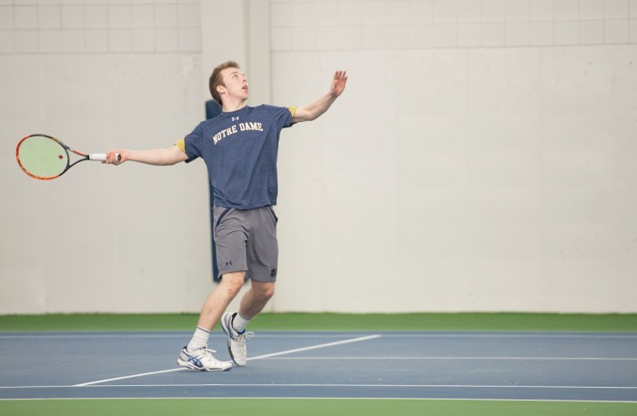 Irish freshman Matt Gamble starts his serve during Notre Dame's 7-0 win over Boston College on Feb. 11 at Eck Tennis Center.