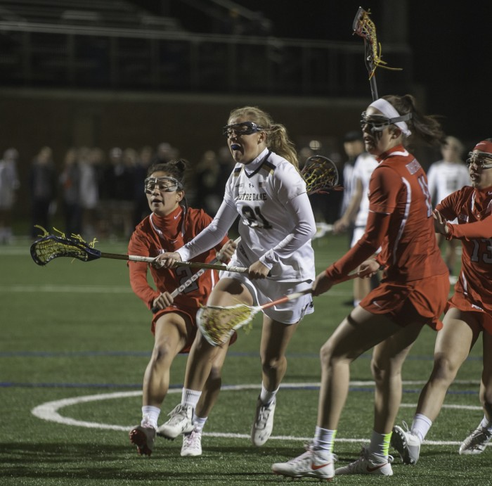 Irish senior attack Grace Muller fights through a crowd of Ohio State defenders during Notre Dame's 16-13 win over the Buckeyes on March 7 at Arlotta Stadium.