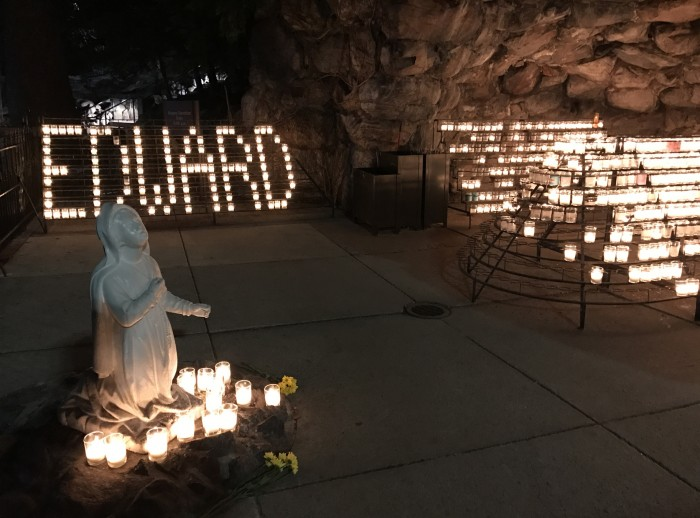 Edward Lim's name is written out in candles at the grotto Wednesday. Lim, a former Notre Dame student, passed away Friday.
