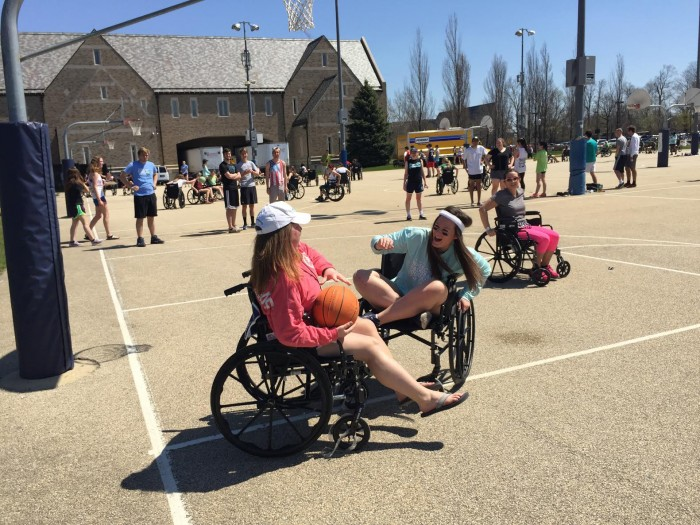 Students participate in a wheelchair basketball organized by Ryan Hall to benefit Whirlwind Wheelchair International.