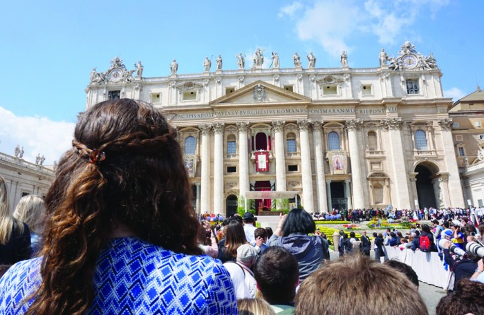 "Junior Elizabeth Crimmins watches Pope Francis deliver his traditional ""Urbi et Orbi"" Easter message. The pope celebrated Easter Mass in Vatican City and traveled through the crowd in his popemobile."