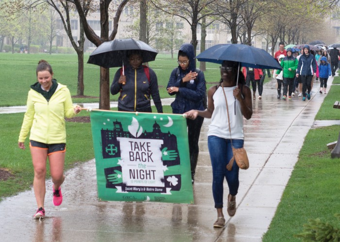 Participants in last year's Take Back the Night event march around campus to raise awareness for issues of sexual assault before ending the night with a prayer vigil at the Grotto.