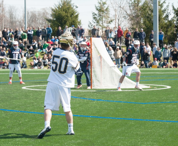 Irish sophomore attack Ryder Garnsey passes the ball during Notre Dame's 11-10 loss to Syracuse on April 1 at Arlotta Stadium.