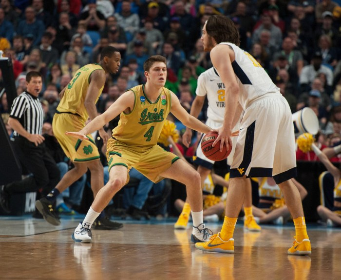 Notre Dame forward Matt Ryan plays defense during the team's 83-71 loss to West Virginia at KeyBank Center on March 18.