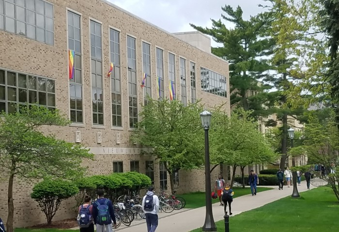 Pride flags hang from the windows of Nieuwland Hall. The flags, distributed by student groups, are being displayed as a sign of protest against this year's Commencement speaker, Vice President Mike Pence.