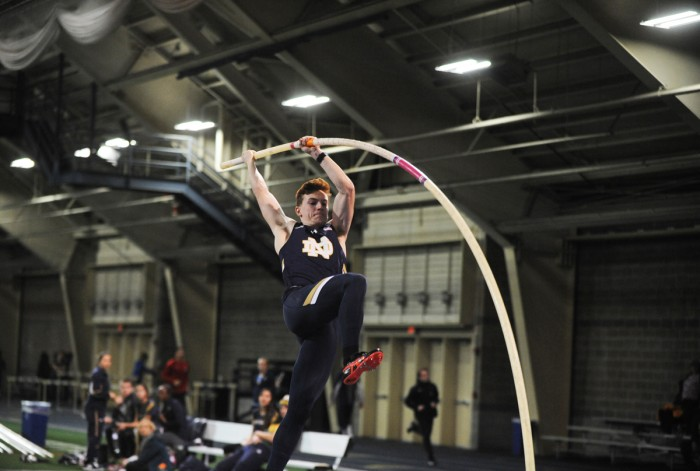Irish senior pole vaulter Nathan Richartz leaps into a jump during the Blue-Gold Invitational on Dec. 2 at Loftus Sports Center.