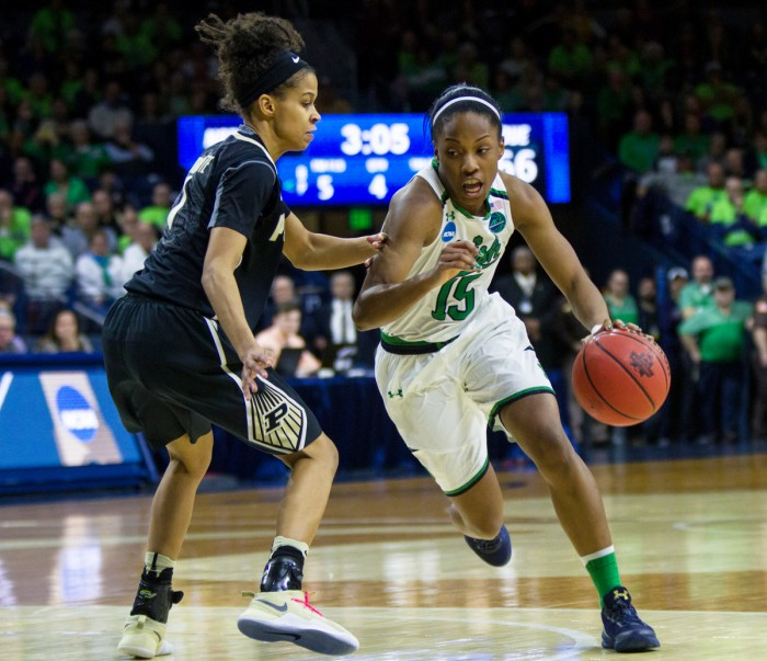 Irish senior guard Lindsay Allen drives around a defender during Notre Dame's 88-82 overtime win over Purdue in the second round of the NCAA tournament on March 19 at Purcell Pavilion.