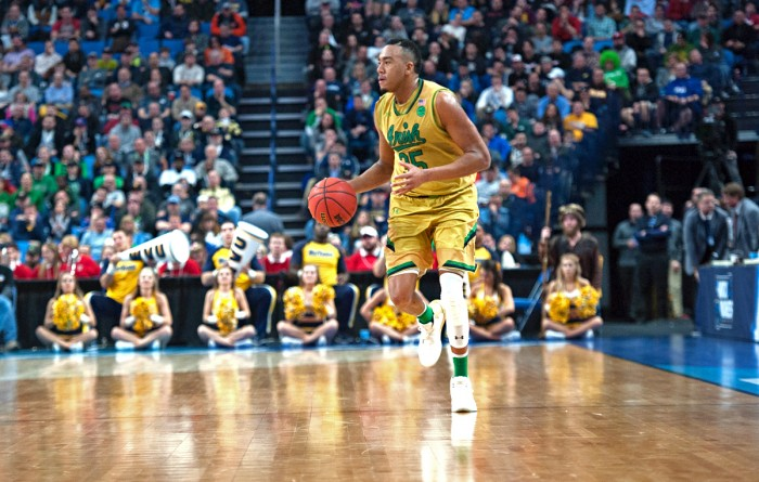 Irish junior forward Bonzie Colson dribbles down the court during Notre Dame's 83-71 loss to West Virginia on March 18.