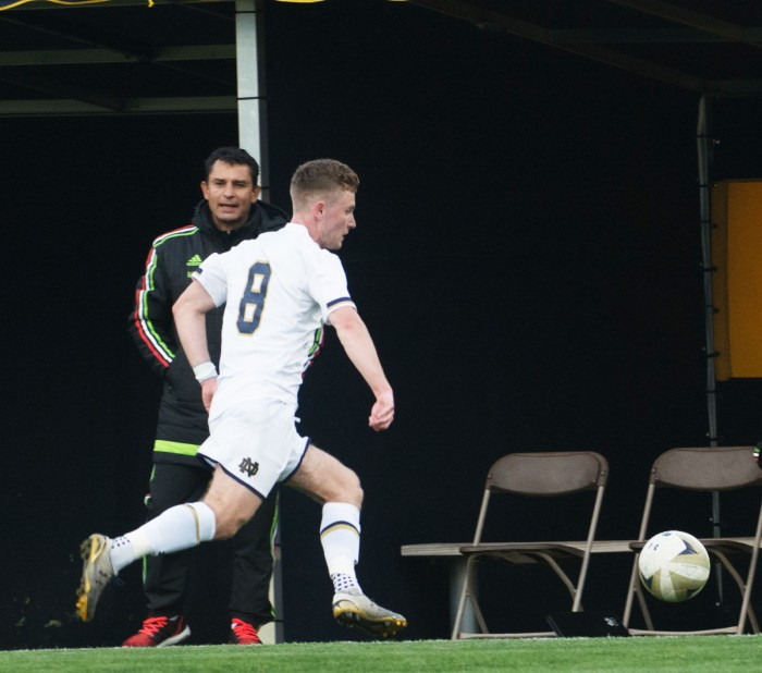 Irish senior forward Jon Gallagher tracks down the ball during Notre Dame's 5-0 victory over the Mexico U-18s on April 28 at Alumni Stadium. Gallagher led the team in goals and assists last season.