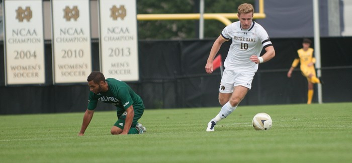 Irish captain and senior forward Jon Gallagher speeds past a fallen defender during Notre Dame's 2-1 overtime victory over Cal Poly on Sunday at Alumni Stadium. Gallagher leads the team in shots this year.