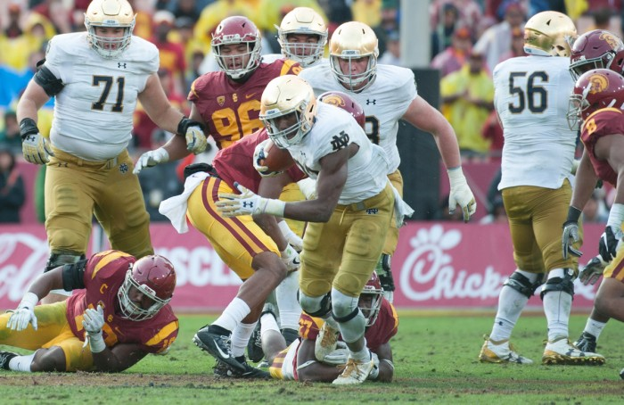 Irish junior running back Josh Adams pushes past a defender  during Notre Dame's 45-27 loss to USC in Los Angeles on Nov. 26.