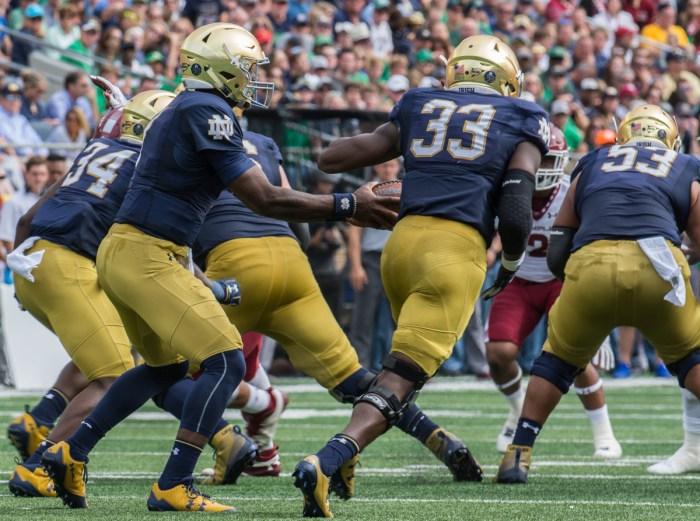 Irish junior running back Josh Adams accepts the handoff from junior quarterback Brandon Wimbush during Notre Dame's 49-16 win over Temple on Saturday at Notre Dame Stadium.