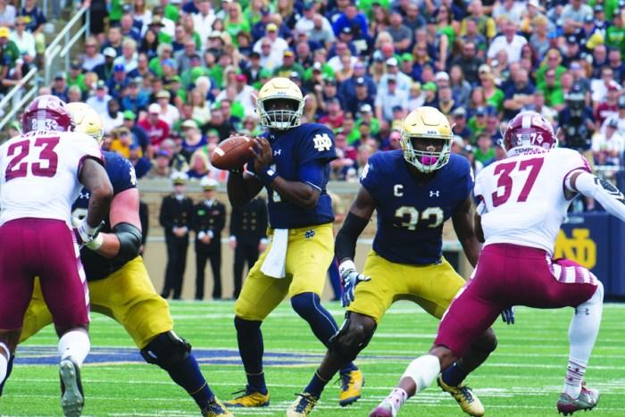 Irish junior quarterback Brandon Wimbush drops back to pass during Notre Dame's 49-16 win over Temple on Saturday.
