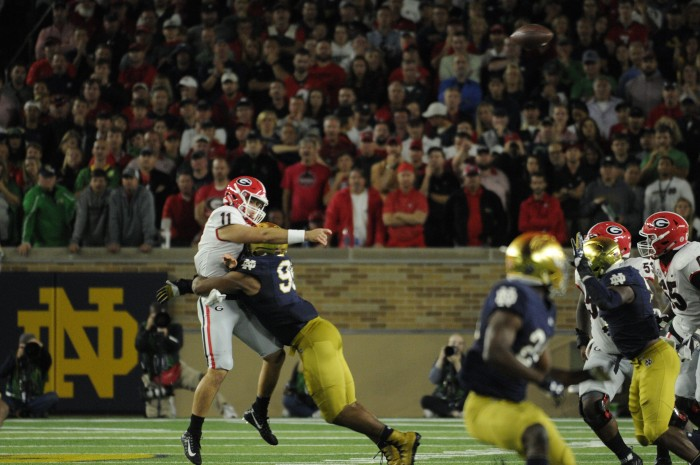 Irish junior defensive lineman Jerry Tillery takes down freshman Georgia quarterback Jake Fromm in Notre Dame's 20-19 loss to the Bulldogs at Notre Dame Stadium on Saturday.