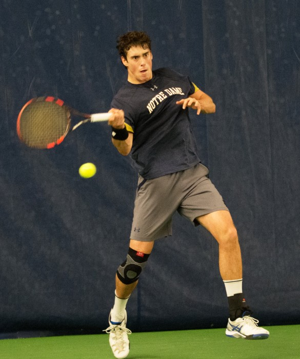 Irish junior Alex Lebedev hits a forehand during Notre Dame's 4-1 victory over Northwestern on Feb. 24. Lebedev lost his singles match but won his doubles match with his partner, sophomore Matt Gamble.