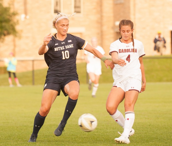Irish sophomore forward Jennifer Westendorf dribbles around a defender during Notre Dame's 1-0 double-overtime loss to South Carolina on Sept. 1 at Alumni Stadium.