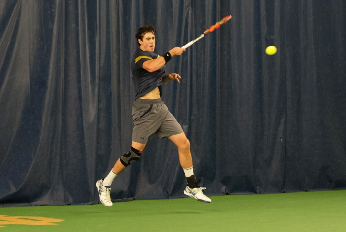 Irish Junior Alex Lebedev rises for a shot during Notre Dame's 4-1 victory over Northwestern on Feb. 24 at Eck Tennis Pavilion. Lebedev earned the second most wins on the team last season with 22.