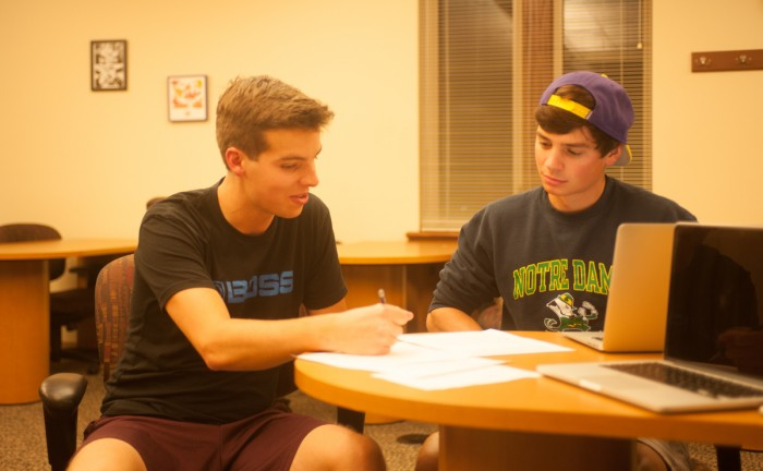 A student consults with a tutor in the Coleman-Morse location of the Writing Center.