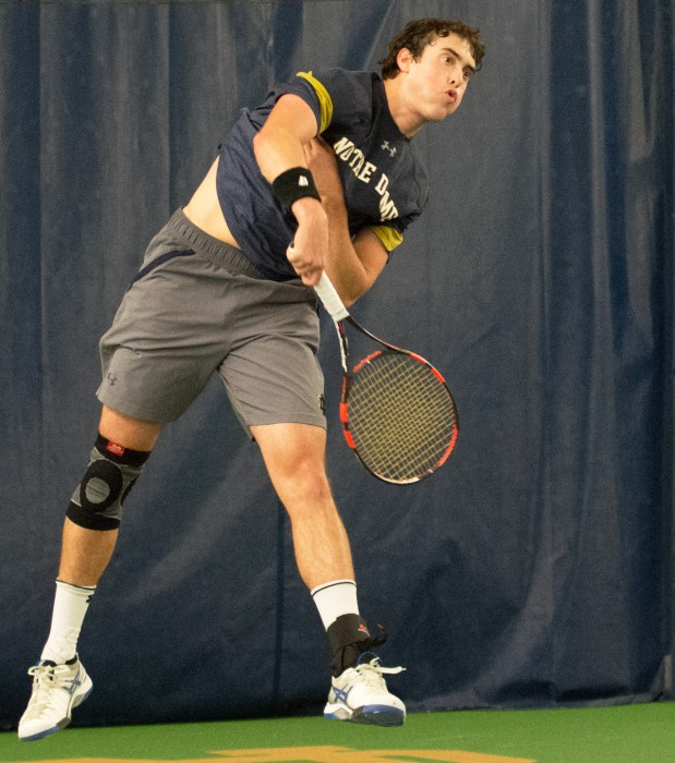 Irish junior Alex Lebedev follows through on a serve during Notre Dame's 4-1 win over Northwestern on Feb. 24 at Eck Tennis Pavilion.