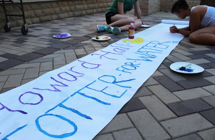 Howard Hall residents paint a banner for their signature event, Totter for Water. The event benefits Engineers Without Borders, an organization that works on sustainability issues.