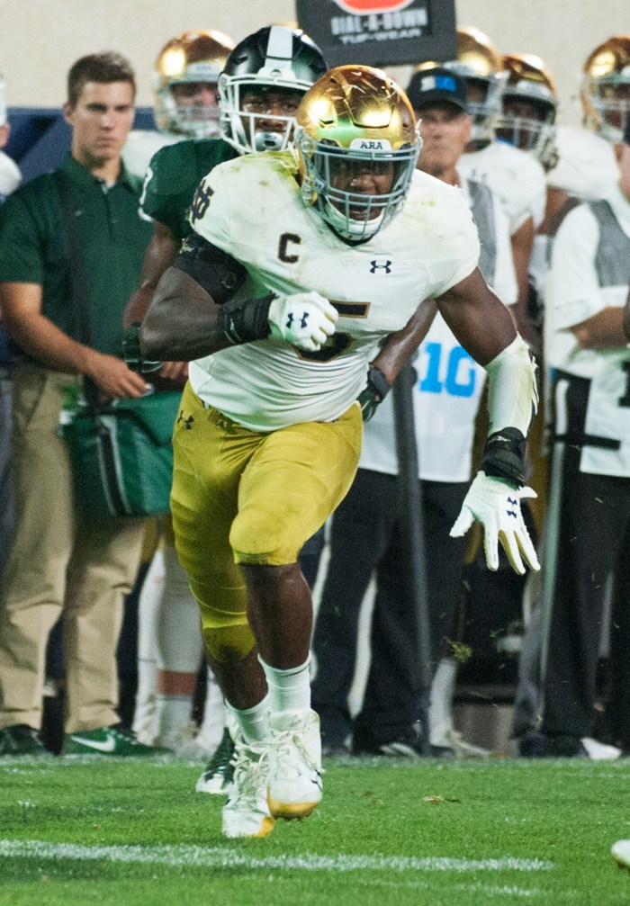 Irish captain and senior linebacker Nyles Morgan chases an opponent during Notre Dame's 38-18 victory over Michigan State on Sept. 23 at Spartan Stadium.