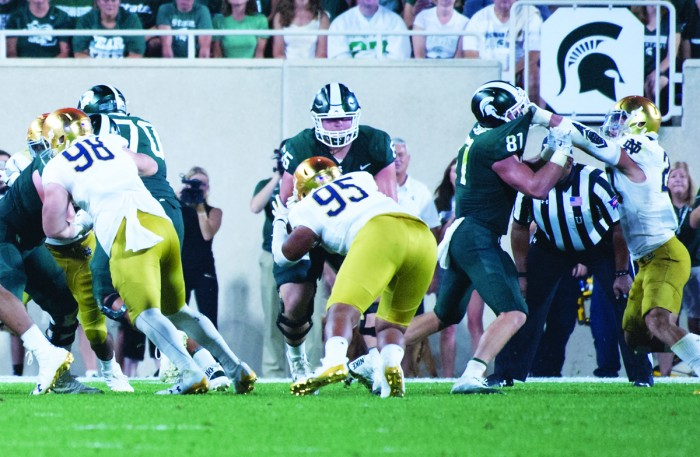 Irish freshman defensive line Myron Tagovailoa-Amosa tackles an opponent during Notre Dame's 38-18 win over Michigan State on Saturday in East Lansing, Michigan.