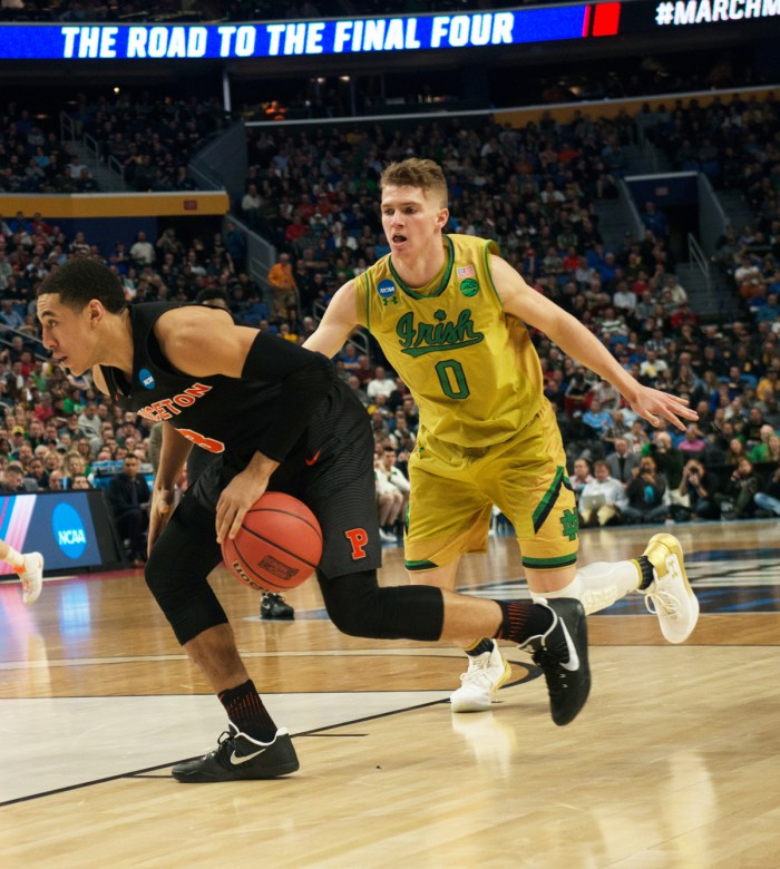Irish junior guard Rex Pflueger chases Tigers junior guard Devin Cannady during Notre Dame's 60-58 win in the first round of the NCAA tournament over Princeton at KeyBank Center on March 16.