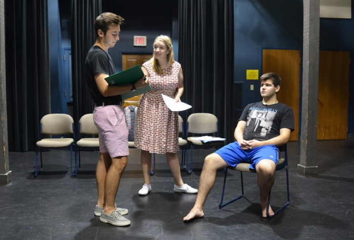 """Cast members rehearse for PEMCo's production of """"A New Brain"""", while director Caroline Lezny looks on. The play will run from October 5-7 in Washington Hall."""