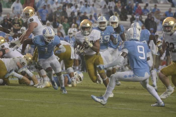 Irish sophomore running back Deon McIntosh skirts around a defender during Notre Dame's 33-10 win over North Carolina on Saturday at Kenan Memorial Stadium in Chapel Hill, North Carolina.
