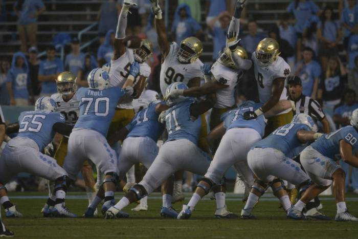 Irish junior defensive lineman Jerry Tillery, middle, and the Irish defensive line attempt to block an extra-point attempt during Notre Dame's 33-10 win over North Carolina on Saturday at Kenan Memorial Stadium in Chapel Hill, North Carolina.