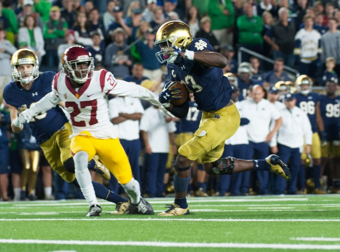 Irish junior running back Josh Adams rushes past a defender during Notre Dame's 49-14 victory over  USC on Saturday at Notre Dame Stadium. Adams tallied 191 yards on 19 carries in the game.