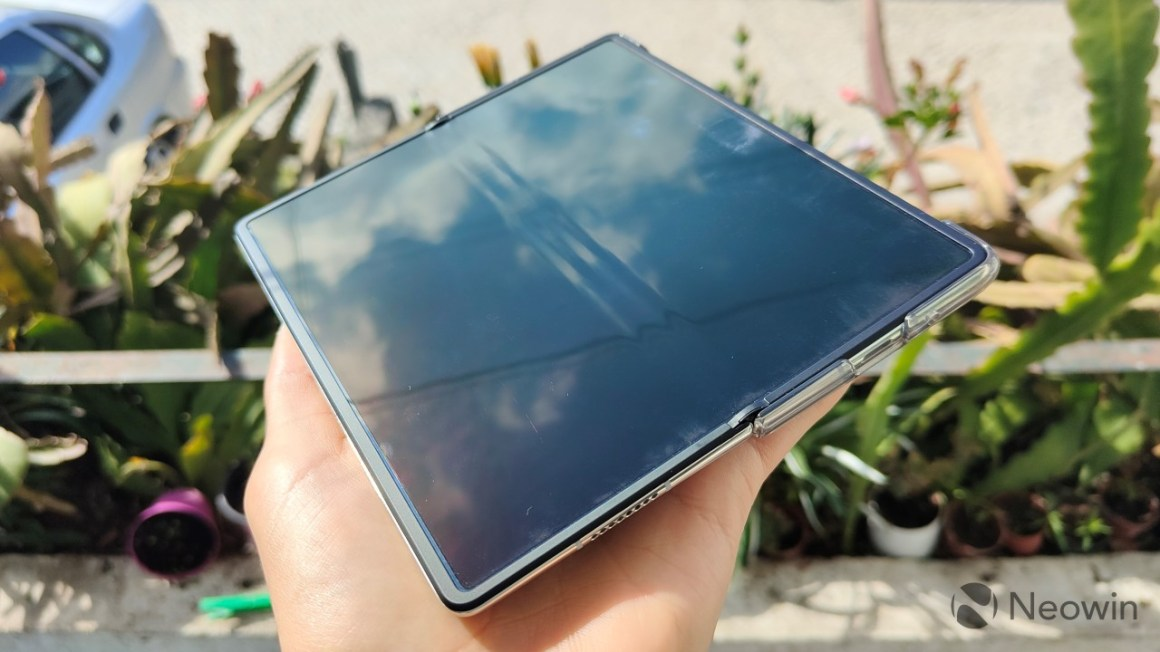 An unfolded Huawei Mate X2 with the display turned off showing the triple crease near the hinge