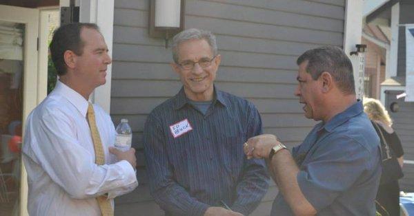 Rep. Adam Schiff and Ed Buck (center) outside a house in California.