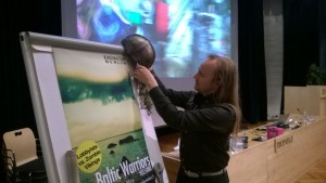 Mike Pohjola places a viking helmet on top of a flapboard at our Baltic Warriors presentation.