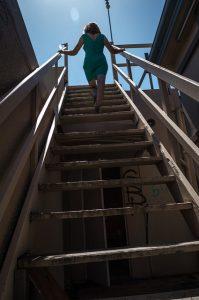 a woman climbing a staircase