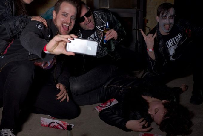 smiling vampires over a dead body