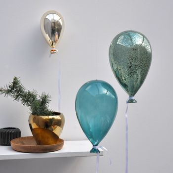 Glass balloon, from left: gold, transparent teal and mercury teal Unique And Quirky Gift Ideas Any Odd Person Will Appreciate (Fun Gifts!)