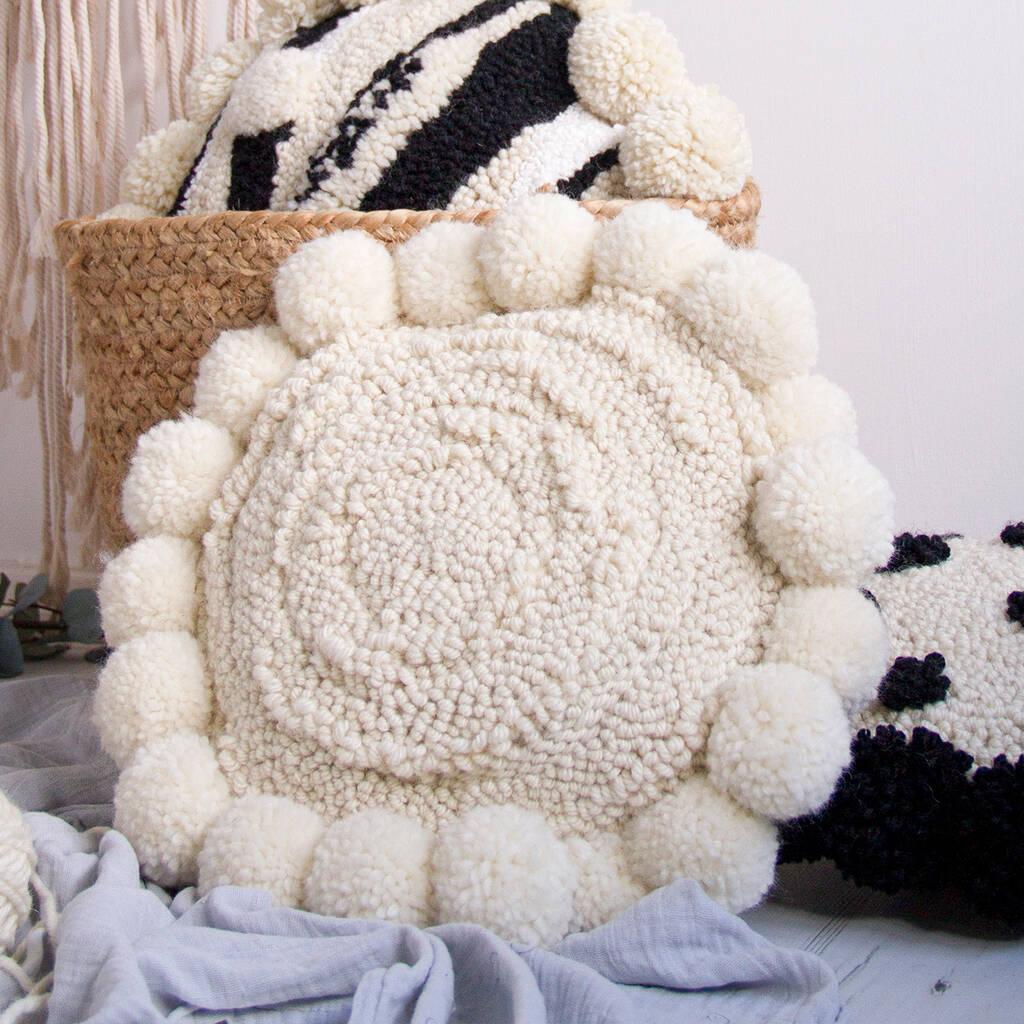 textured round pompom cushion